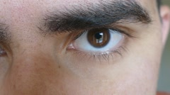 Brown eyes with eyebrow. Part of man's face Stock Footage