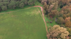 Motocross in a park in the countryside. Vertical shot. Aerial drone video N. Stock Footage