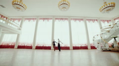 Professional dancers dancing tango in ballroom Stock Footage