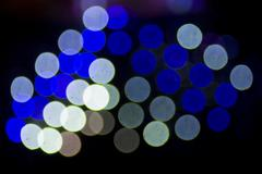 Abstract defocus lights over black Stock Photos