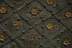 Steel monastery door texture with flowers ornament Stock Photos