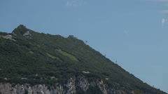 Closeup of the Gibraltar Rock with a cable car Stock Footage