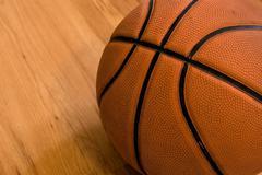 Basketball over wooden floor. Close up. Kuvituskuvat
