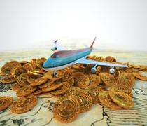 Passenger plane with gold coins travel business background concept Stock Illustration