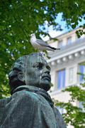 Seagull on the statue Stock Photos