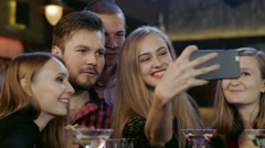 Company of young people is taking selfie in the bar Stock Footage