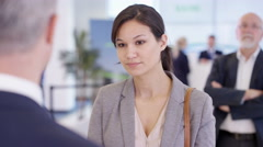 4K Friendly bank workers talking to customer & offering advice about a loan - stock footage