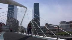 Low angle pan of people crossing the Zubizuri bridge Stock Footage