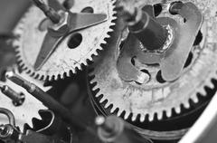 Black white Cogwheels Clockwork. Macro Stock Photos