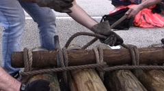 Pulling rope to fasten the trunks of a raft Stock Footage