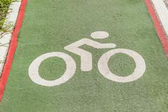 Bicycle sign or icon on the road in the park - stock photo