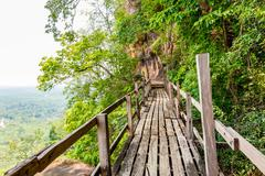 Wooden walkway on sandstone mountains Stock Photos