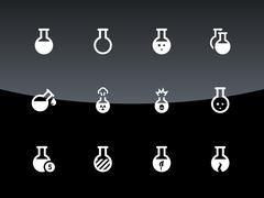 Laboratory bulb icons on black background - stock illustration