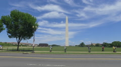 People on segways in front of monument in Washington DC Stock Footage