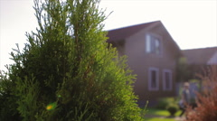 Brown House With a Beautiful Garden in Rural Area Stock Footage