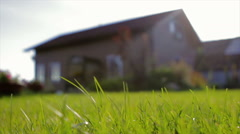 A Private Brown Wooden House. Shot Through Grass Stock Footage