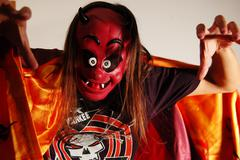 Long hair man in devil mask. Time to Halloween Party Stock Photos