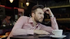 Sad young man in a bar Stock Footage