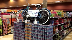 Enter to win a palm bay bike inside BC liquor store Stock Footage