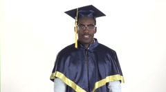 Man in dressed for graduation. White. Slow motion. Close up Stock Footage