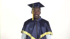 Male graduate shows thumb. White. Slow motion. Close up Stock Footage