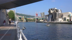 View of Bilbao Guggenheim from under a nearby bridge Stock Footage