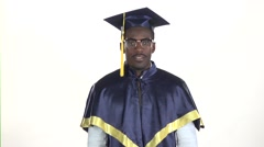 Graduate showing thumbs down. White. Slow motion. Close up Stock Footage