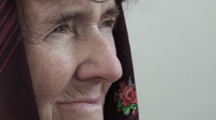 Pensive old woman closeup footage: side portrait of worried elder woman Stock Footage