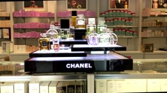 Motion of display famous Chanel and Coco perfume inside the bay store Stock Footage