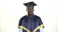Graduate displease. Student disappointed. White. Slow motion. Close up Stock Footage
