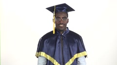 Graduation in glasses showing thumbs. White. Slow motion. Close up Stock Footage