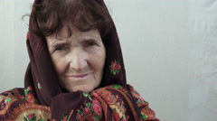 Pensive old woman closeup footage: side portrait of worried elder woman Stock Footage