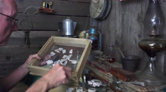 ARCHEAEOLOGIST STUDYING POTTERY SHARDS, pottery relics - stock footage