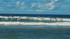 Wide shot of the start of men's surf ski race on the sunshine coast of australia Stock Footage