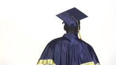 Graduate threatens with a finger. White. Slow motion. Close up Stock Footage