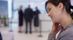 4K Bank customer waits to meet with financial adviser with to discuss a loan - stock footage