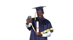 Student takes a photo with a diploma. Slow motion. White Stock Footage