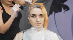 Stylist Beauty Studio causes the paint to hair to locks of blonde - stock footage