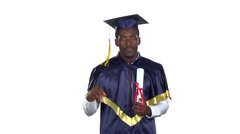 Student with a diploma and the academic hat. Slow motion. White Stock Footage