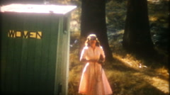 Young woman uses bathroom facility at national park-3379 vintage film home movie Stock Footage