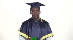 Graduate holding a green card. White. Slow motion. Close up Stock Footage