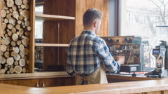 Professional barista working in the cafe Stock Footage