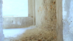 A free runner back flips off a wall of catacomb in slow motion Stock Footage