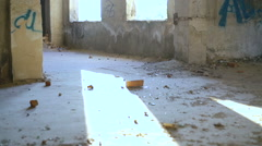 A free runner back flips off a wall of catacomb. Slowly Stock Footage