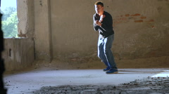 Kickboxer shadow boxing as exercise for the big fight in catacomb. Slow motion - stock footage