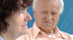 Pensive and worried elderly people: thoughtful married couple with problems Stock Footage