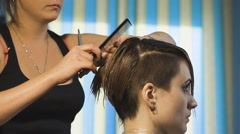Business woman making a stylish haircut. Professional hairdresser - stock footage