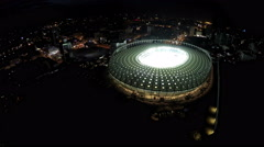 Night city sparkling with lights, aerial view of arena for sports competitions Arkistovideo