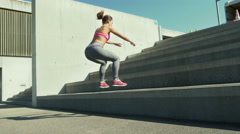 Young woman performing a set of Plyo Hops Stock Footage
