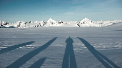 Shadow Figures On An Arctic Landscape - stock footage